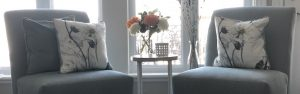 two slipper chairs with accent table